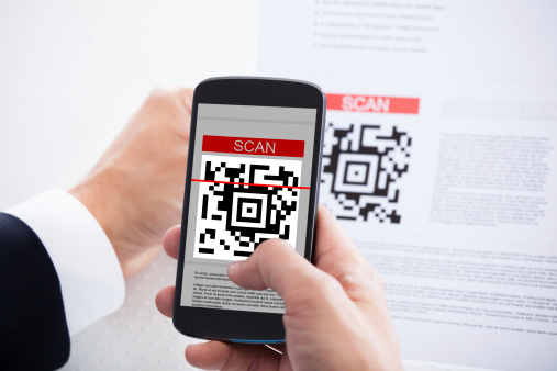 Close-up Of Businessman Scanning A Barcode